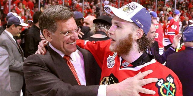 Jun 15, 2015; Chicago, IL, USA; Chicago Blackhawks right wing Patrick Kane (88) celebrates with owner Rocky Wirtz after defeating the Tampa Bay Lightning in game six of the 2015 Stanley Cup Final at United Center. Mandatory Credit: Dennis Wierzbicki-USA TODAY Sports