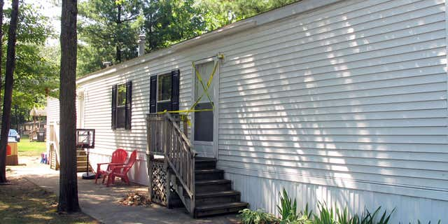 Aug. 14, 2015: Photo shows the mobile home where a couple and their two young children were found dead in Grand Traverse County's Garfield Township, Michigan, according to authorities.