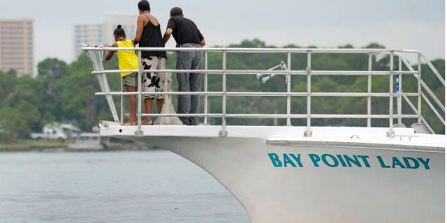 Aug. 15: President Obama, first lady Michelle Obama, and their daughter Sasha watch a porpoise as they take a boat ride in St. Andrews Bay in Panama City Beach, Fla.