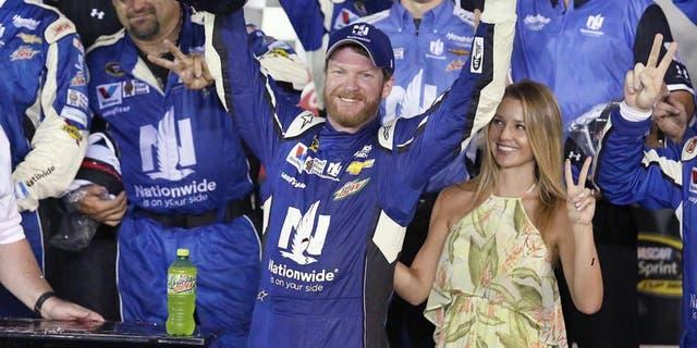 Dale Earnhardt Jr. celebrates in Victory Lane after winning the Coke Zero 400 NASCAR Sprint Cup race at Daytona International Speedway on Sunday, July 5, 2015 in Daytona Beach, Fla. (Stephen M. Dowell/Orlando Sentinel/TNS via Getty Images)