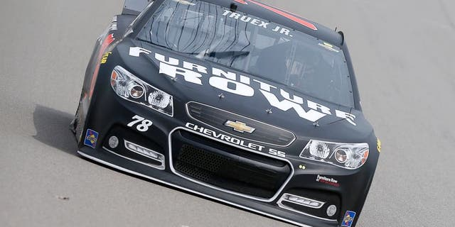 BROOKLYN, MI - AUGUST 14: Martin Truex Jr. drives the #78 Furniture Row/Visser Precision Chevrolet during practice for the NASCAR Sprint Cup Series Pure Michigan 400 at Michigan International Speedway on August 14, 2015 in Brooklyn, Michigan. (Photo by Brian Lawdermilk/NASCAR via Getty Images)