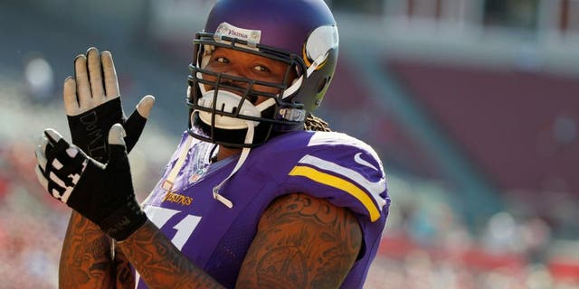 Oct 26, 2014; Tampa, FL, USA; Minnesota Vikings tackle Phil Loadholt (71) reacts prior to the game against the Tampa Bay Buccaneers at Raymond James Stadium. Mandatory Credit: Kim Klement-USA TODAY Sports