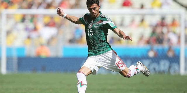 FORTALEZA, BRAZIL - JUNE 29: Hector Moreno of Mexico in action during the 2014 FIFA World Cup Brazil Round of 16 match between Netherlands and Mexico at Castelao on June 29, 2014 in Fortaleza, Brazil. (Photo by Dean Mouhtaropoulos/Getty Images)