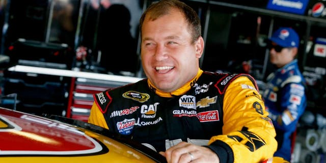 BROOKLYN, MI - AUGUST 15: Ryan Newman, driver of the #31 Caterpillar Chevrolet, climbs into his car during practice for the NASCAR Sprint Cup Series Pure Michigan 400 at Michigan International Speedway on August 15, 2015 in Brooklyn, Michigan. (Photo by Gregory Shamus/Getty Images)