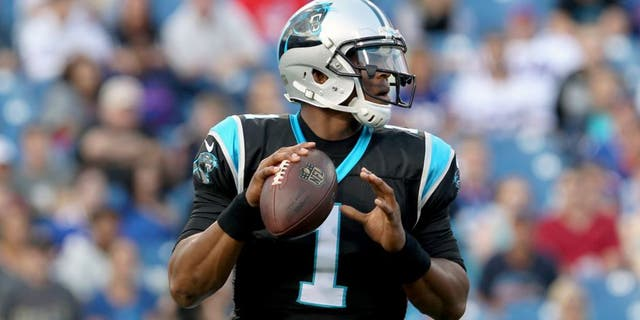 Aug 14, 2015; Orchard Park, NY, USA; Carolina Panthers quarterback Cam Newton (1) looks to make a pass attempt during the first quarter against the Buffalo Bills in a preseason NFL football game at Ralph Wilson Stadium. Mandatory Credit: Timothy T. Ludwig-USA TODAY Sports
