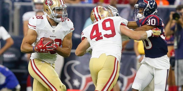 HOUSTON, TX - AUGUST 15: Jarryd Hayne #38 of the San Francisco 49ers rushes with the ball as he gets a block from Bruce Miller #49 on Kevin Johnson #30 of the Houston Texans during a preseason football game at NRG Stadium on August 15, 2015 in Houston, Texas. Houston won 23-10. (Photo by Bob Levey/Getty Images)