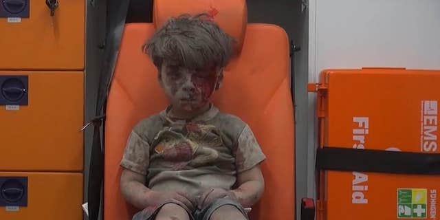 Aug. 17, 2016: In this frame grab taken from video provided by the Syrian anti-government activist group Aleppo Media Center (AMC), a child sits in an ambulance after being pulled out or a building hit by an airstirke, in Aleppo, Syria.