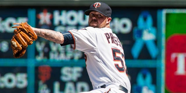 Jun 21, 2015; Minneapolis, MN, USA; Minnesota Twins relief pitcher Ryan Pressly (57) Minnesota Twins throws a pitch during the sixth inning against the Chicago Cubs at Target Field. The Cubs won 8-0. Mandatory Credit: Jeffrey Becker-USA TODAY Sports