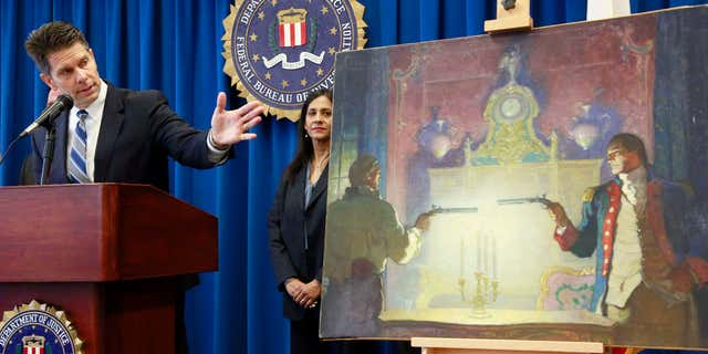 Aug. 18, 2015: David Bowdich FBI Assistant Director in Charge, left, and and FBI Special Agent Elizabeth Rivas speak at a news conference in Los Angeles.