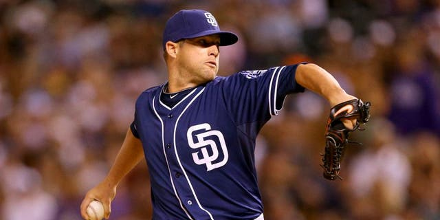 DENVER, CO - AUGUST 14: Relief pitcher Bud Norris #20 of the San Diego Padres delivers to home plate during the sixth inning against the Colorado Rockies at Coors Field on August 14, 2015 in Denver, Colorado. The Padres defeated the Rockies 9-5. (Photo by Justin Edmonds/Getty Images)