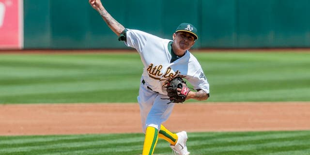 Aug 19, 2015; Oakland, CA, USA; Oakland Athletics starting pitcher Jesse Chavez (30) throws a pitch against the Los Angeles Dodgers during the second inning at O.co Coliseum. Mandatory Credit: Ed Szczepanski-USA TODAY Sports