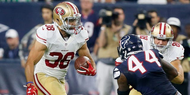 HOUSTON, TX - AUGUST 15: Jarryd Hayne #38 of the San Francisco 49ers rushes past Carlos Thompson #44 of the Houston Texans during a preseason football game at NRG Stadium on August 15, 2015 in Houston, Texas. Houston won 23-10. (Photo by Bob Levey/Getty Images)