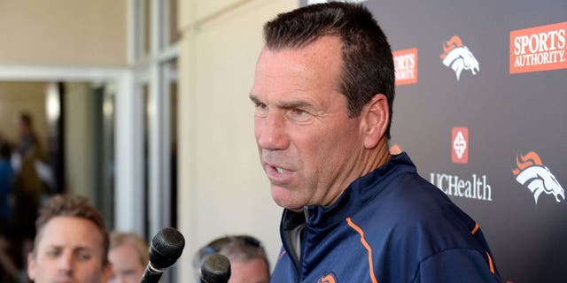 Aug 12, 2015; Englewood, CO, USA; Denver Broncos head coach Gary Kubiak speaks to the media following training camp activities at the UCHealth Training Center. Mandatory Credit: Ron Chenoy-USA TODAY Sports