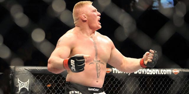 LAS VEGAS - JULY 11: Brock Lesnar reacts after knocking out Frank Mir during their heavyweight title bout during UFC 100 on July 11, 2009 in Las Vegas, Nevada. (Photo by Jon Kopaloff/Getty Images) *** Local Caption *** Brock Lesnar