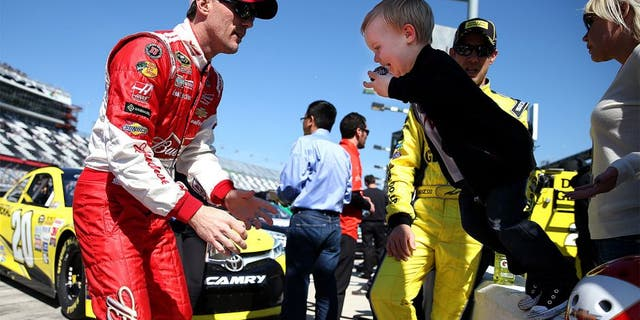 DAYTONA BEACH, FL - FEBRUARY 15: Kevin Harvick, driver of the #4 Budweiser/Jimmy John's Chevrolet, and his son Keelan during qualifying for the 57th Annual Daytona 500 at Daytona International Speedway on February 15, 2015 in Daytona Beach, Florida. (Photo by Patrick Smith/NASCAR via Getty Images)