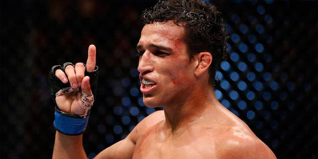 AUCKLAND, NEW ZEALAND - JUNE 28: Charles Oliveira reacts after his submission victory over Hatsu Hioki in their featherweight fight during the UFC Fight Night event at Vector Arena on June 28, 2014 in Auckland, New Zealand. (Photo by Josh Hedges/Zuffa LLC/Zuffa LLC via Getty Images) *** Local Caption *** Charles Oliveira