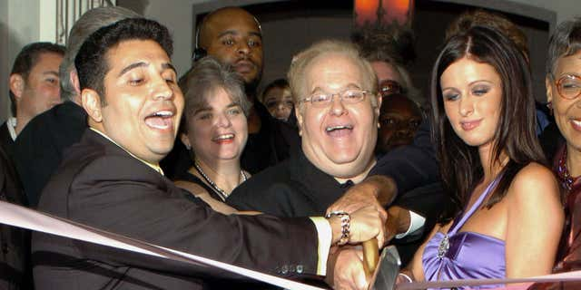 Dec. 30, 2004: Orlando business man Fred Khalilian (L) entertainment mogul Lou Pearlman (C) and hotel heiress Nicky Hilton (R) cut the ribbon at the grand opening of Club Paris in Orlando, Fla.