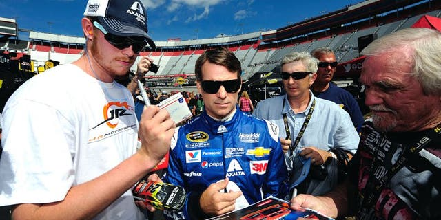 BRISTOL, TN - AUGUST 21: Jeff Gordon, driver of the #24 Axalta Chevrolet, signs autographs during practice for the NASCAR Sprint Cup Series Irwin Tools Night Race at Bristol Motor Speedway on August 21, 2015 in Bristol, Tennessee. (Photo by Jeff Curry/NASCAR via Getty Images)