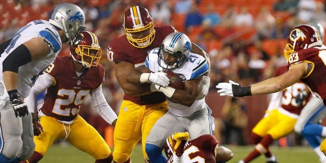 Aug 20, 2015; Landover, MD, USA; Detroit Lions running back Ameer Abdullah (21) carries the ball as Washington Redskins inside linebacker Perry Riley (56) and Redskins defensive tackle Stephen Paea (90) make the tackle in the first quarter at FedEx Field. Mandatory Credit: Geoff Burke-USA TODAY Sports