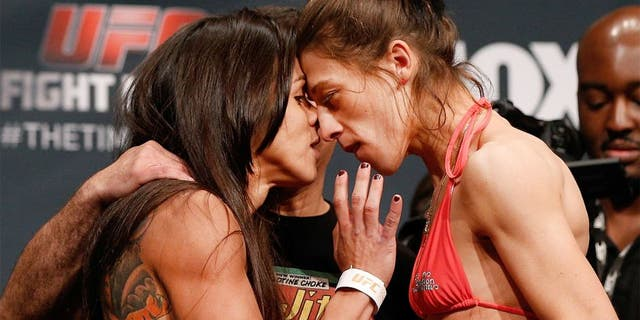 PHOENIX, AZ - DECEMBER 12: (L-R) Opponents Claudia Gadelha of Brazil and Joanna Jedrzejczyk of Poland face off during the UFC Fight Night weigh-in event at the Phoenix Convention Center on December 12, 2014 in Phoenix, Arizona. (Photo by Josh Hedges/Zuffa LLC/Zuffa LLC via Getty Images)