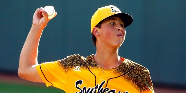 Taylors, South Carolina pitcher Alex Edmondson delivers during the first inning of a baseball game in United States pool play against Cranston, Rhode Island at the Little League World Series tournament in South Williamsport, Pa., Friday, Aug. 21, 2015. (AP Photo/Gene J. Puskar)