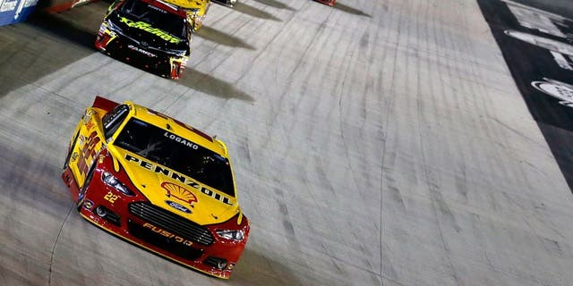 BRISTOL, TN - AUGUST 22: Joey Logano, driver of the #22 Shell Pennzoil Ford, leads a pack of cars during the NASCAR Sprint Cup Series IRWIN Tools Night Race at Bristol Motor Speedway on August 22, 2015 in Bristol, Tennessee. (Photo by Gregory Shamus/Getty Images)