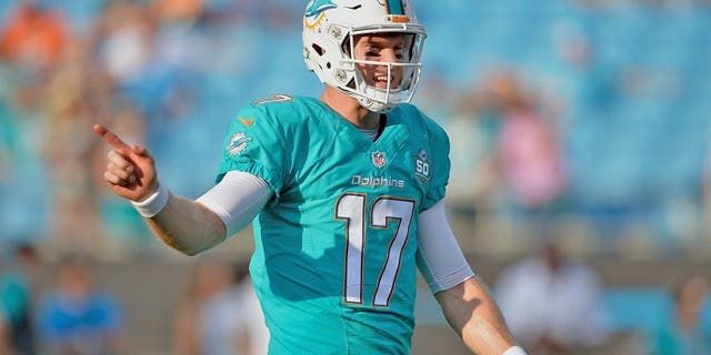 CHARLOTTE, NC - AUGUST 22: Ryan Tannehill #17 of the Miami Dolphins directs his teammates during their preseason NFL game against the Carolina Panthers at Bank of America Stadium on August 22, 2015 in Charlotte, North Carolina. (Photo by Grant Halverson/Getty Images)