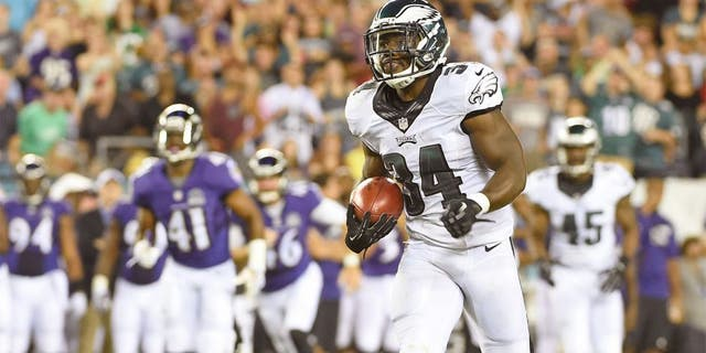 Aug 22, 2015; Philadelphia, PA, USA; Philadelphia Eagles running back Kenjon Barner (34) returns a punt 64-yards for a touchdown against the Baltimore Ravens during the first half at Lincoln Financial Field. Mandatory Credit: Eric Hartline-USA TODAY Sports