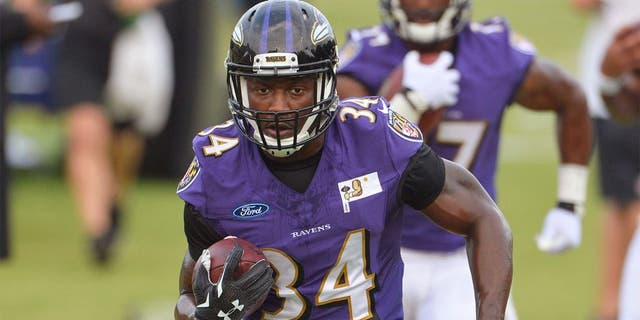 Jul 30, 2015; Owings Mills, MD, USA; Baltimore Ravens running back Lorenzo Taliaferro (34) carries the ball during drills on day one of training camp at Under Armour Performance Center. Mandatory Credit: Tommy Gilligan-USA TODAY Sports