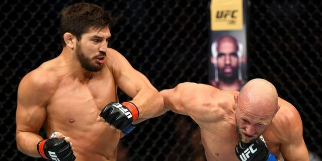 SASKATOON, SK - AUGUST 23: (L-R) Patrick Cote punches Josh Burkman of the United States in their welterweight bout during the UFC event at the SaskTel Centre on August 23, 2015 in Saskatoon, Saskatchewan, Canada. (Photo by Jeff Bottari/Zuffa LLC/Zuffa LLC via Getty Images)