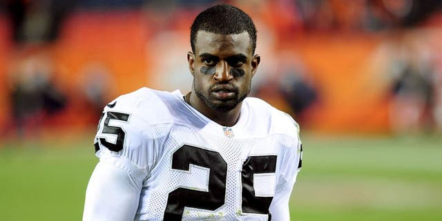 Sep 23, 2013; Denver, CO, USA; Oakland Raiders cornerback DJ Hayden (25) after the game against the Denver Broncos at Sports Authority Field at Mile High. The Broncos won 37-21. Mandatory Credit: Chris Humphreys-USA TODAY Sports