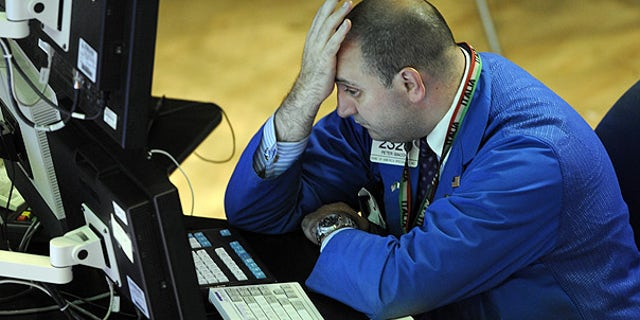 Aug. 19: Bank of America Specialist Peter Giacchi reacts on the floor of the New York Stock Exchange.