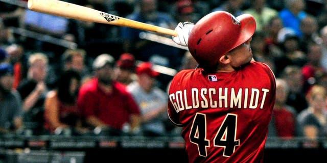 Aug 26, 2015; Phoenix, AZ, USA; Arizona Diamondbacks first baseman Paul Goldschmidt (44) hits a solo home run during the first inning against the St. Louis Cardinals at Chase Field. Mandatory Credit: Matt Kartozian-USA TODAY Sports
