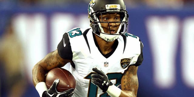 Aug 22, 2015; East Rutherford, NJ, USA; Jacksonville Jaguars wide receiver Rashad Greene (13) runs after a catch during the first half at MetLife Stadium. Mandatory Credit: Danny Wild-USA TODAY Sports