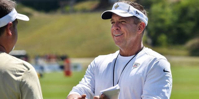 Aug 3, 2015; White Sulphur Springs, WV, USA; New Orleans Saints head coach Sean Payton speaks with a member of his staff following a day of training camp at The Greenbrier. Mandatory Credit: Michael Shroyer-USA TODAY Sports