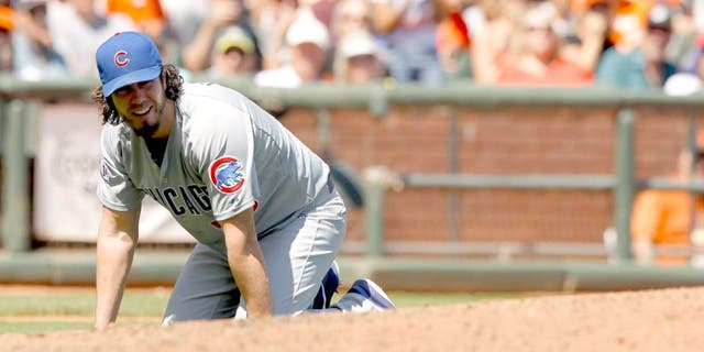 Aug 27, 2015; San Francisco, CA, USA; Chicago Cubs pitcher Dan Haren (50) kneels on the ground after fielding an infield single against the San Francisco Giants in the fourth inning at AT&T Park. The Giants defeated the Cubs 9-1. Mandatory Credit: Cary Edmondson-USA TODAY Sports
