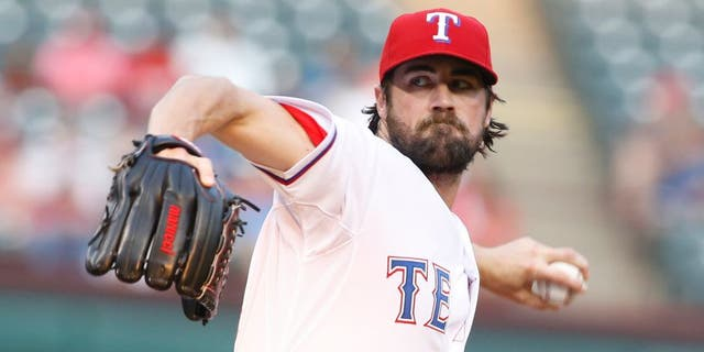 Aug 28, 2015; Arlington, TX, USA; Texas Rangers starting pitcher Cole Hamels (35) throws a pitch in the first inning at bat at Globe Life Park in Arlington. Mandatory Credit: Tim Heitman-USA TODAY Sports