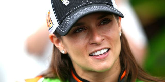 SPARTA, KY - JULY 10: Danica Patrick, driver of the #10 GoDaddy Chevrolet, looks on in the garage area during practice for the NASCAR Sprint Cup Series Quaker State 400 Presented by Advance Auto Parts at Kentucky Speedway on July 10, 2015 in Sparta, Kentucky. (Photo by Sarah Crabill/Getty Images)