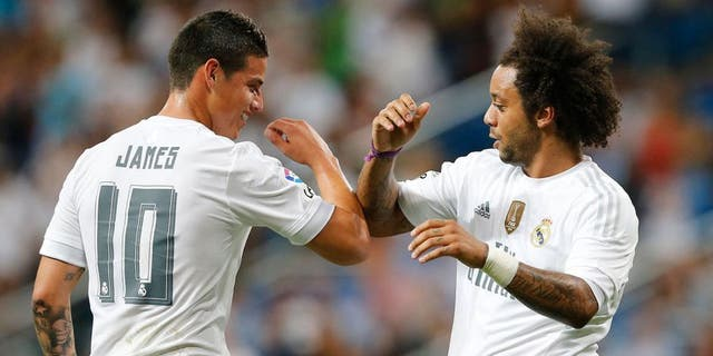 MADRID, SPAIN - AUGUST 18: Marcelo (R) and James Rodriguez of Real Madrid celebrate after scoring during the Santiago Bernabeu Trophy match between Real Madrid and Galatasaray at Estadio Santiago Bernabeu on August 18, 2015 in Madrid, Spain. (Photo by Helios de la Rubia/Real Madrid via Getty Images)