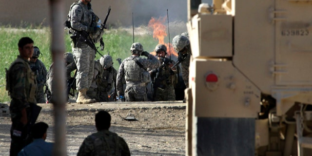 Aug. 30: U.S. and Afghan soldiers gather at the scene of a roadside bomb attack in Kandahar, Afghanistan.