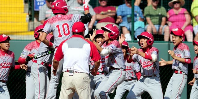 Aug 30, 2015; Williamsport, PA, USA; Japan Region outfielder Kengo Tomita (14) celebrates after hitting a home run in the second inning against the Mid-Atlantic Region at Howard J. Lamade Stadium. Mandatory Credit: Evan Habeeb-USA TODAY Sports