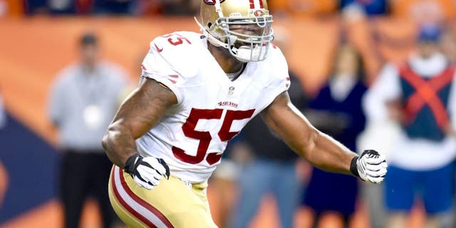 Oct 19, 2014; Denver, CO, USA; San Francisco 49ers outside linebacker Ahmad Brooks (55) reacts after a play in the first quarter against the Denver Broncos at Sports Authority Field at Mile High. Mandatory Credit: Ron Chenoy-USA TODAY Sports