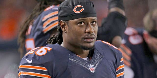 Dec 15, 2014; Chicago, IL, USA; Chicago Bears cornerback Tim Jennings (26) on the sideline during the second quarter against the New Orleans Saints at Soldier Field. Mandatory Credit: Dennis Wierzbicki-USA TODAY Sports