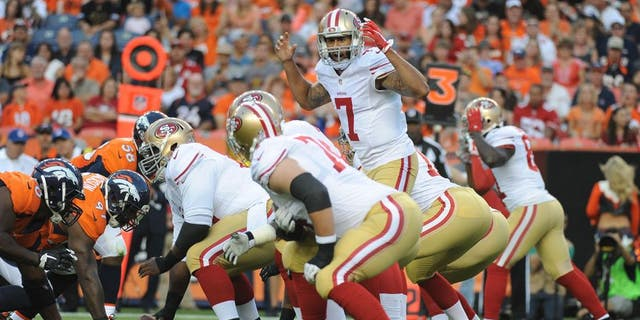 DENVER, CO - AUGUST 29: San Francisco 49ers quarterback Colin Kaepernick in the first half against the Denver Broncos at Sports Authority Field at Mile High on Saturday, August 29, 2015. (Photo by Steve Nehf/The Denver Post via Getty Images)
