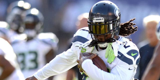Aug 29, 2015; San Diego, CA, USA; Seattle Seahawks running back Marshawn Lynch (24) runs the ball before the game against the San Diego Chargers at Qualcomm Stadium. Mandatory Credit: Jake Roth-USA TODAY Sports