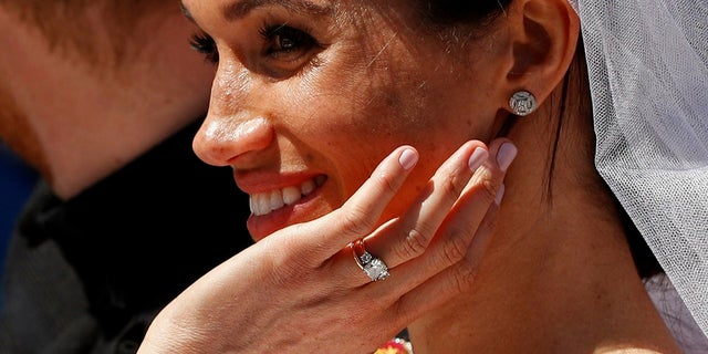 Meghan Markle shows off her ring after marrying Prince Harry on Saturday, May 19, 2018.