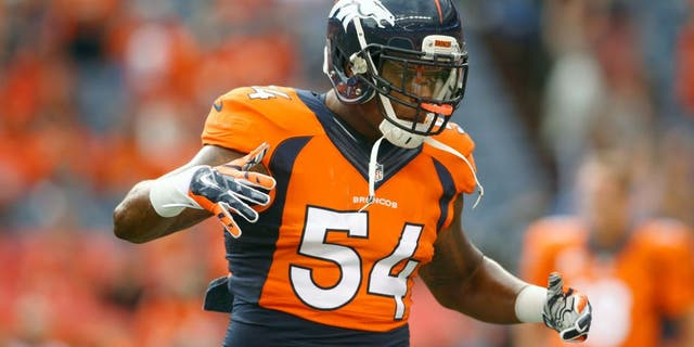 Sep 7, 2014; Denver, CO, USA; Denver Broncos linebacker Brandon Marshall (54) before the game against the Indianapolis Colts at Sports Authority Field at Mile High. Mandatory Credit: Chris Humphreys-USA TODAY Sports