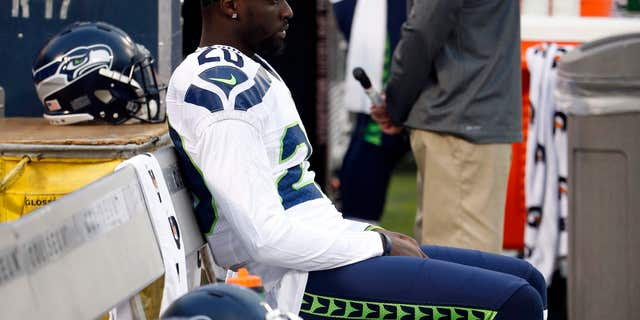 While Seahawks and Raiders players stood for the national anthem, Seattle corner back Jeremy Lane opted to sit.