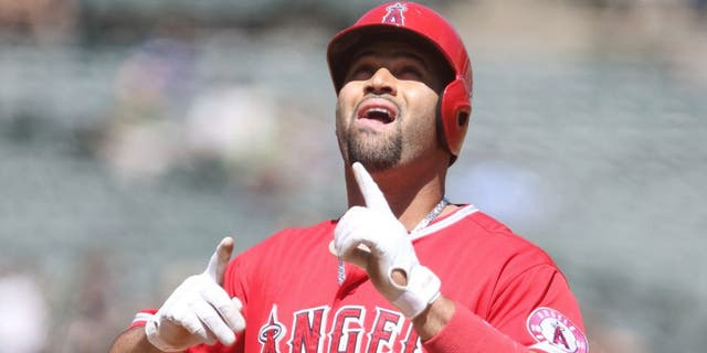 Sep 2, 2015; Oakland, CA, USA; Los Angeles Angels designated hitter Albert Pujols (5) celebrates after hitting a two run home run against the Oakland Athletics during the second inning at O.co Coliseum. Mandatory Credit: Kelley L Cox-USA TODAY Sports