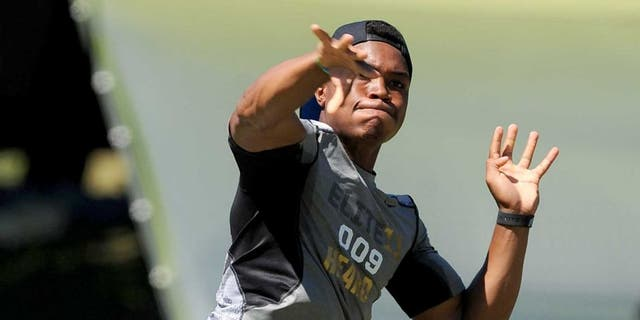 June 30, 2013; Beaverton, OR, USA; Jerrod Heard, of Denton, Texas, passes the ball during the morning session of the Elite 11 at Nike World Headquarters. Mandatory Credit: Steve Dykes-USA TODAY Sports